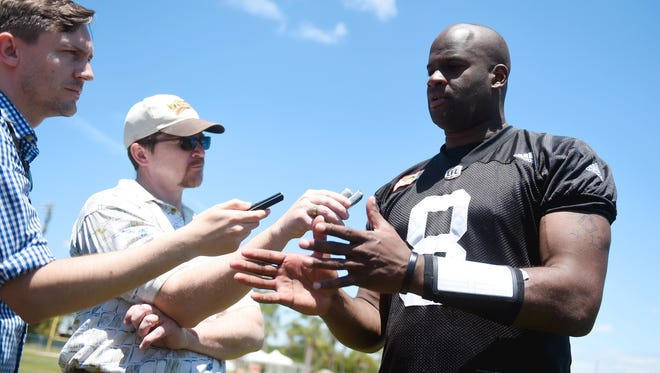 Former University of Texas and NFL quarterback Vince Young fields questions from the media, Tuesday, April 25, 2017, after the day's practice with the Saskatchewan Roughriders at Historic Dodgertown in Vero Beach, Fla.