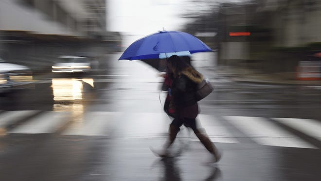 File photo. Rain is expected to continue Saturday night, perhaps into Sunday morning.
