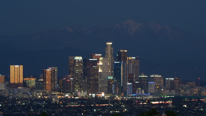 Jan 5, 2015; Los Angeles, CA, USA; General view of the downtown Los Angeles skyline and San Gabriel mountains before the NBA game between the Atlanta Hawks and Los Angeles Clippers.