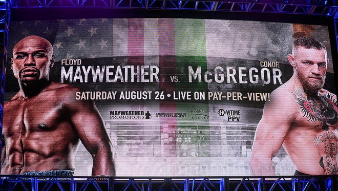 Signage on stage of Floyd Mayweather and Connor McGregor before the world tour press conference to promote the upcoming boxing fight at Staples Center.