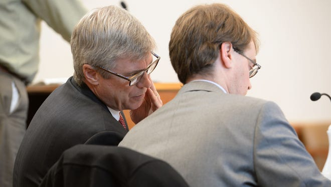 Attorneys Thomas Snyder, left, and Thomas Isler confer in Judge Devin Odell's courtroom at the Larimer County Justice Center on Thursday, February 23, 2017.