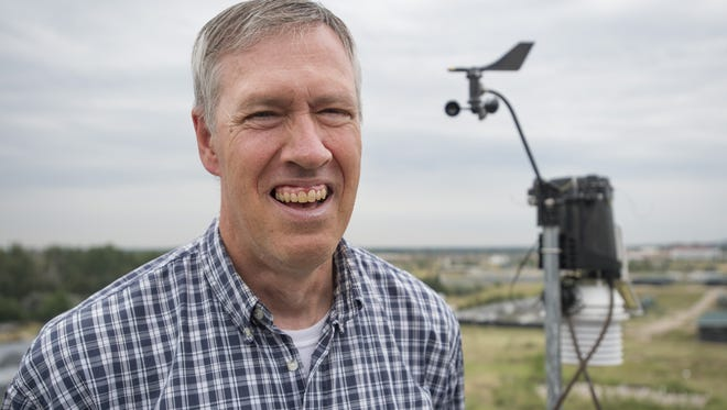 State Climatologist Nolan Doesken poses for a photo outside of the Department of Atmospheric Sciences at Colorado State University's Foothills Campus.