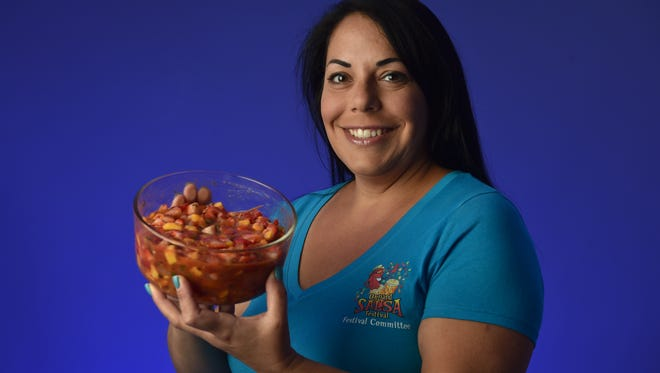 Cathy Moreno, of Oxnard, holds a bowl of Strawberry Kiwi Salsa. Moreno's recipe can also be made with an assortment of other fruit combinations.