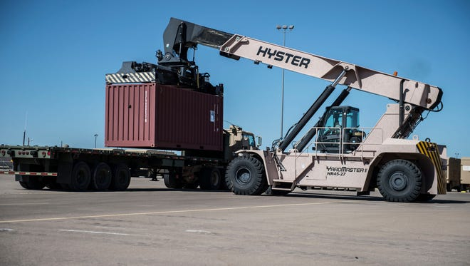 A Hyster 100k Reach Stacker loads equipment at Holloman Air Force Base N.M., July 28, 2017, to be delivered by members of Army's 424th Transportation Company to be used during Patriot Warrior at Fort McCoy, Wis. Patriot Warrior is a joint field training exercise that replicates all aspects of combat medical service support, and without the cargo provided by Holloman and the delivery made by Army's 424th Transportation Company Patriot Warrior could not happen.
