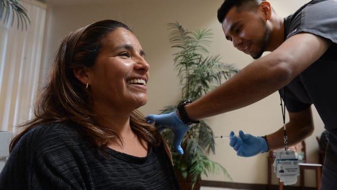 A patient receives a flu shot at a Clinicas site in Fillmore.