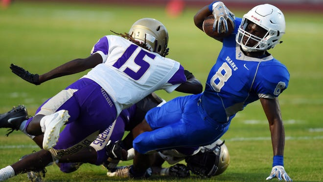 Sebastian River High School's Javian Tomlinson (8) is brought down by Okeechobee's Elton Pelt (15) and Jajuan Cherry just short of a first down during a spring football jamboree in May at Sebastian River High School. Twelve area teams play in preseason Kickoff Classics on Friday.