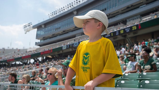 A young Rams fan watches a scrimmage on Sonny Lubick Field during an open house for CSU's new on-campus football stadium Aug. 5. More than 20,000 Rams fans got their first look at the facility, which will host its first game Saturday, when  the Rams face Oregon State.