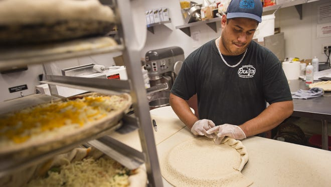 "Tony Vega prepares pizza dough for baking at Beau Jo's Pizza on N. College Avenue on Thursday, August 31, 2017. The pizza joint, known for its ""Colorado Style Pizza"" has been an Old Town staple for years."