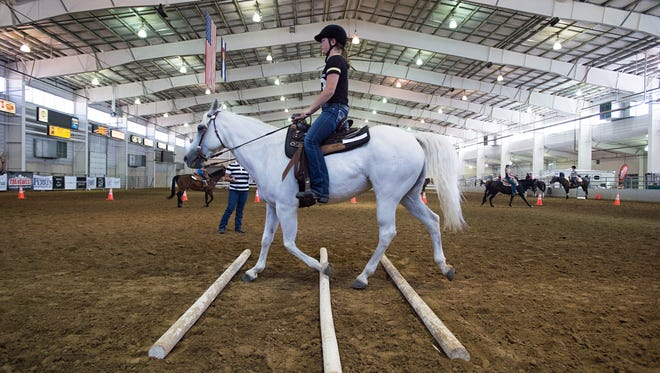 "Emma Litchford and her horse, Lily, participate in a horse ""boot camp"" at The Ranch, Larimer County's fairgrounds complex in Loveland."