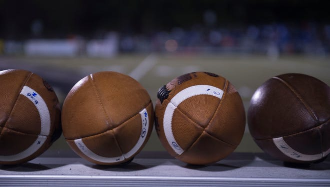 Footballs line the bench at halftime during the game between the Memorial Tigers and the Mater Dei Wildcats at the Reitz Bowl in Evansville, Ind., on Friday, Sept. 8, 2017. Memorial won 37-14.