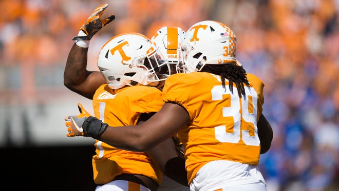 Tennessee defensive lineman Jonathan Kongbo (1) and Tennessee defensive lineman Kendal Vickers (39) celebrate with a teammate during the Tennessee Volunteers vs. Indiana State Sycamores game at Neyland Stadium in Knoxville, Tenn. Saturday, Sept. 9, 2017.
