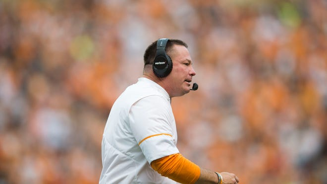 Butch Jones walks on the sidelines during the Tennessee Volunteers vs. Indiana State Sycamores game at Neyland Stadium in Knoxville, Tenn. Saturday, Sept. 9, 2017.