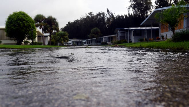 Streets in the Vero Green community in Vero Beach are still flooded Sept. 11, 2017, because of heavy rainfall Hurricane Irma brought to the region.