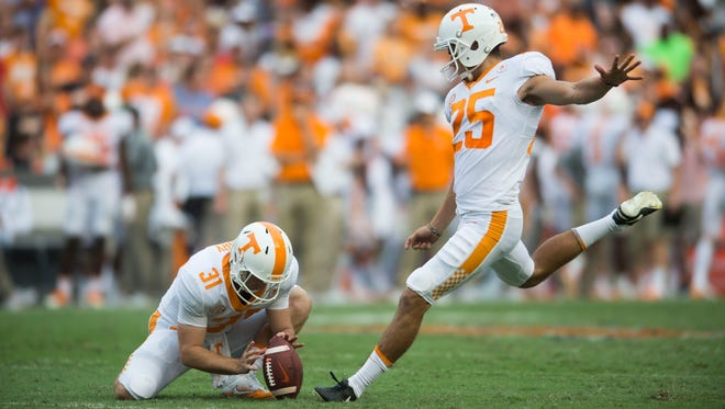 Tennessee H-back Parker Henry (31) holds the ball for Tennessee punt kicker Aaron Medley (25) during the Tennessee Volunteers vs. Florida Gators game at Ben Hill Griffin Stadium in Gainesville, Florida Saturday, Sept. 16, 2017. Florida defeated Tennessee 26-20.