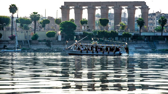 A river boat sails in the Nile River past the Temple of Luxor in the southern Egyptian city on Sept. 9, 2017.