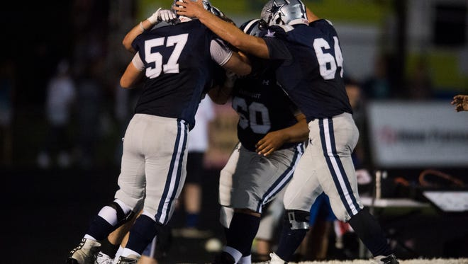 Farragut players celebrate their final touchdown during a high school football game between Science Hill and Farragut at Farragut Friday, Sept. 29, 2017. Farragut defeated Science Hill 35 to 27.