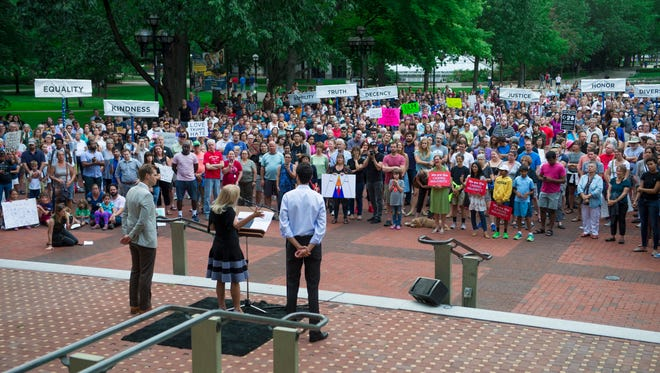 Rallygoers fill the Diag as Congresswoman Debbie Dingell speaks during a rally on the campus of the University of Michigan in Ann Arbor, Mich. on Sunday, Aug. 13, 2017. The rally was held to express solidarity with Charlottesville, Va. after white supremacist protests became violent on Saturday.
