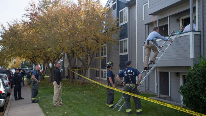Fort Collins police respond to the scene of a fatal shooting investigation at 720 City Park Ave. on Thursday, October 19, 2017.