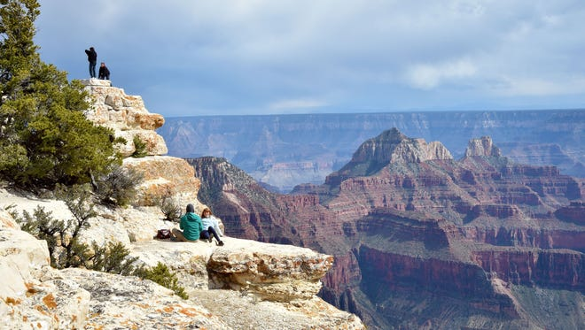 Tourists take photos from the North Rim of the Grand Canyon on May 18, 2015.