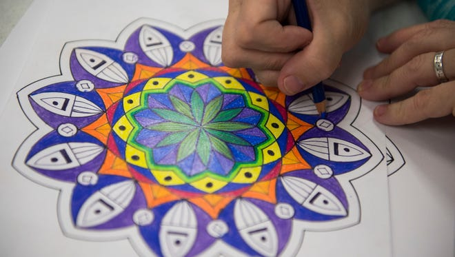 Terry Haberman colors her mandala during a course offered through the Tennessee Valley Unitarian Universalist Church's Adult Religious Education Program on Wednesday Oct. 11, 2017. A mandala is a circular art-form used in many spiritual traditions, and creating one can be a meditative and therapeutic experience.