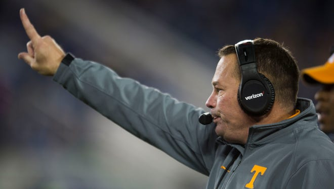 Tennessee Head Coach Butch Jones holds up one finger after the Vols make their first touch down of the game during the Tennessee vs. Kentucky game at Kroger Field in Lexington, Kentucky Saturday, Oct. 28, 2017.