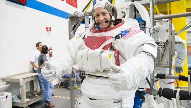 NASA astronaut Serena Aunon, attired in a training version of her Extravehicular Mobility Unit (EMU) spacesuit, awaits the start of a spacewalk training session in the waters of the Neutral Buoyancy Laboratory (NBL) near NASA's Johnson Space Center in this 2012 photo.