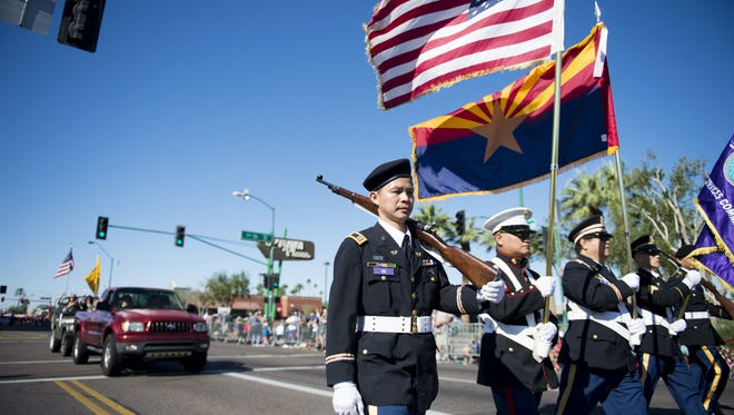 An honor guard leads off the Veterans Day Parade in central Phoenix on Friday, Nov. 11, 2016.