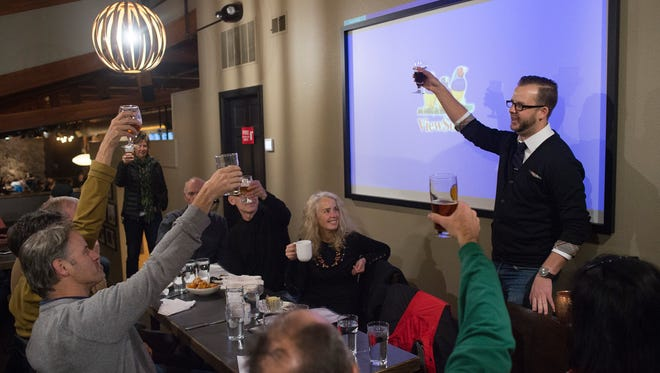 Colin Garfield, right, leads a cheers to passage of a ballot question allowing Fort Collins to establish municipal broadband service in this Nov. 7 file photo taken at The Mayor of Old Town.