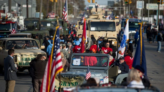Setup takes place before the Four Freedoms Veterans Day Parade on West Franklin Street in Evansville, Ind., on Saturday, Nov. 11, 2017.