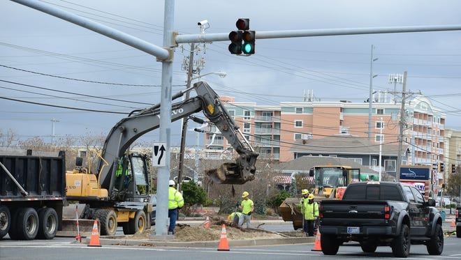 The Maryland State Highway Administration prepares the medians in Ocean City to start construction on the dune-style median fence project for Coastal Highway on Wednesday, Nov. 15, 2017.