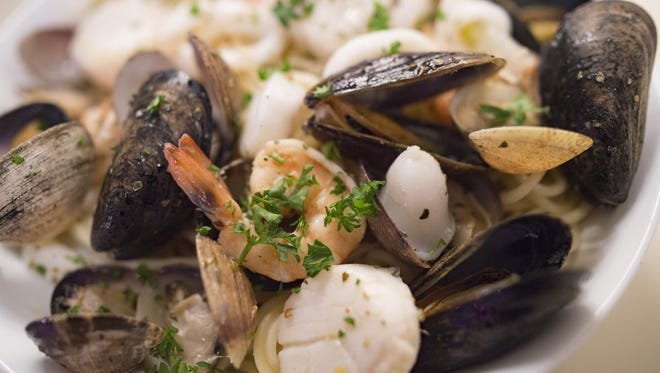 Tomas, a dish with shrimp, scallops, mussels and clams, is served over a bed of spaghetti at Papa's Table in Wellington on Wednesday, November 15, 2017. The new eatery, serving Italian specialties, is the latest to join the rising food scene in Wellington.