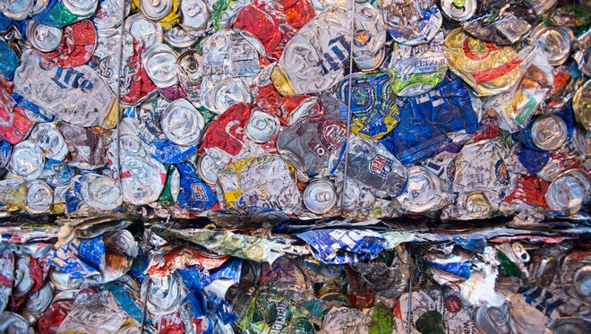 At least 25 tons of recycled waste is processed through the St. Lucie County Single-Stream Recycling Facility each hour, seen Nov. 16, 2017, at the facility in Fort Pierce. After a consumer recycles, a truck picks up the contents of the bin and dumps it at the St. Lucie County Single-Stream Recycling Facility, where it goes through a conveyer system and gets bundled into a bail, like this collection of aluminum. At least 25 tons of recycled waste makes it through the facility each hour.