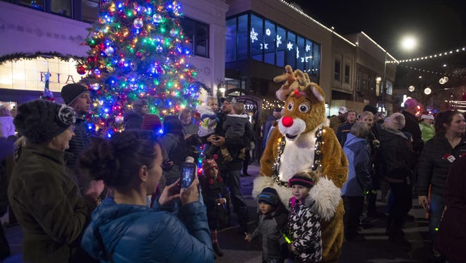 Christmas characters wander through the crowd on Fourth Street during the Festival of Lights in downtown Loveland on Tuesday, Nov. 28, 2017. The event was hosted by the Loveland Downtown Partnership and its partners.