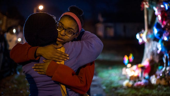 Brittney Young, sister of Janae Carter, hugs her aunt Janice Johnson during a candlelight vigil at the corner of Linwood and Monroe avenues in Evansville, Ind., on Thursday, Nov. 30, 2017. Carter's children, Prince Carter, 7 months, and Princess Carter, 2, both died as a result of the crash following a police chase Wednesday night.