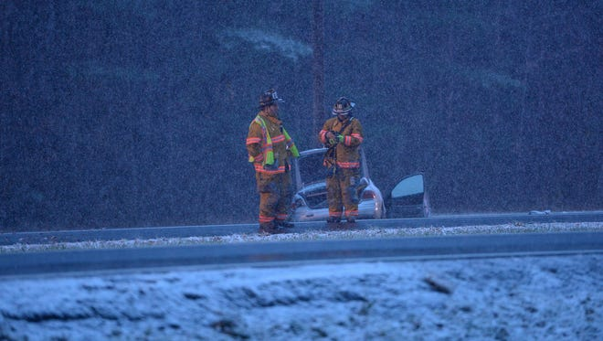 Emergency responders work at the scene of a crash on Business Route 50 near Queen Avenue in Salisbury on Friday evening.