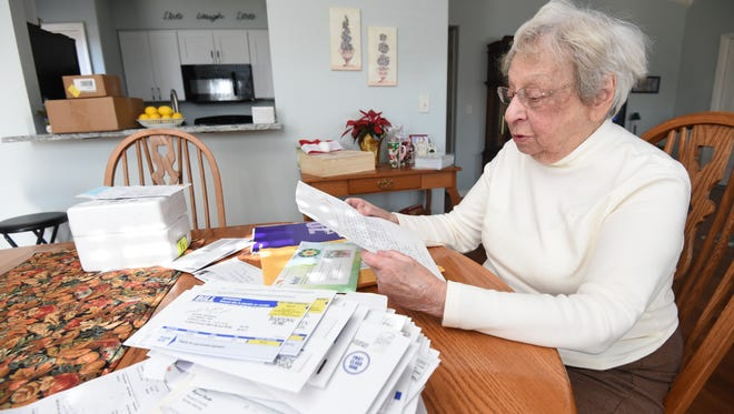 MaryAnn Remington reads a letter from a child sponsorship group sent to her after a spiteful fired health care worker signed her up to sponsor a child. The man also signed her up for 75 magazine subscriptions.