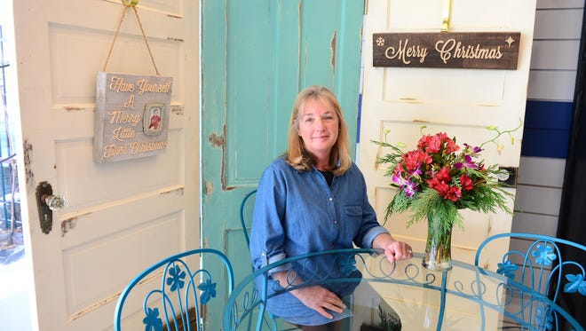 Timeless Charm co-owner Diane Ellison poses for a photo in their newly opened shop in Salisbury on Monday.