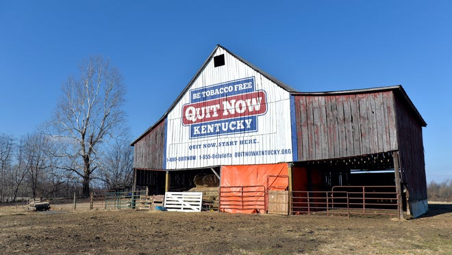Once it stored tobacco, now this 100 year old barn, seen in a Dec. 15, 2017 photo and owned by former tobacco farmer Michael Vaughn, now displays a message for Kentuckians to quit smoking, in Kevil, Ky.