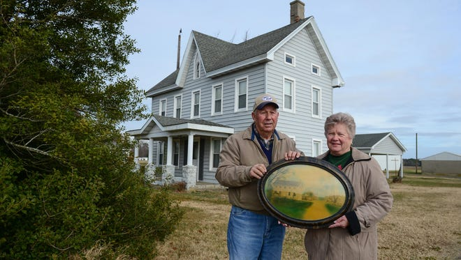 Wayne and Doris Wilkins hold a photo of the farm from back in the 1800's when Wayne's grandfather purchased the land in Georgetown, Del. Their farm was recognized as a 2017 Delaware Century Farm. Friday, Dec. 22, 2017.