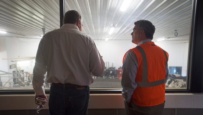 U.S. Sen. Cory Gardner talks with Rob Graves about milk production at Morning Fresh Dairy during a tour in Bellvue on Friday, January 5, 2018.