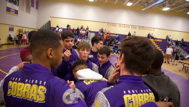 Fort Pierce Central, Wellington, Royal Palm Beach and Jupiter wrestlers compete Thursday, Jan. 11, 2018, at Fort Pierce Central High School. The teams vied for one of the Region 3 berths in Class 3A at the inaugural Florida High School Dual Wrestling State Championships next week.