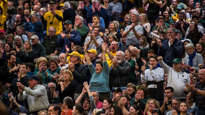 The crowd reacts to a drive by Trae Bell-Haynes, the two-point layup and the foul, earning him one more free-throw point during their game in Burlington, Vt., on Wednesday night, Jan. 24, 2018. UVM won, 61-50.
