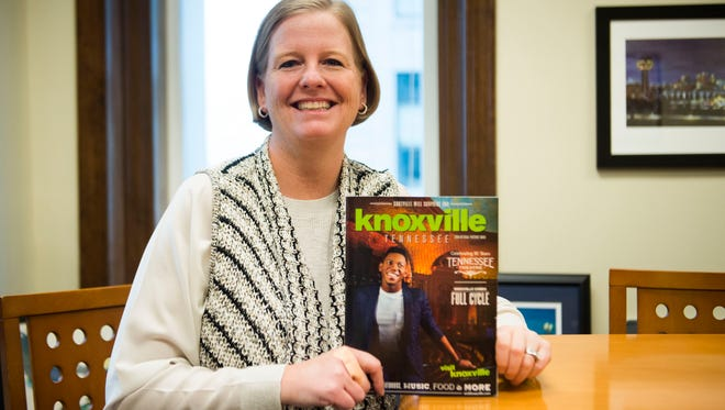 Visit Knoxville president Kim Bumpas holds the new visitor's guide for 2018, which will be released on Thursday, Jan. 25.