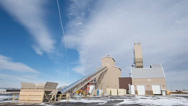 Transport belts head into a ready-mix facility at the Martin Marietta asphalt plant in Johnstown on Wednesday, January 24, 2018.