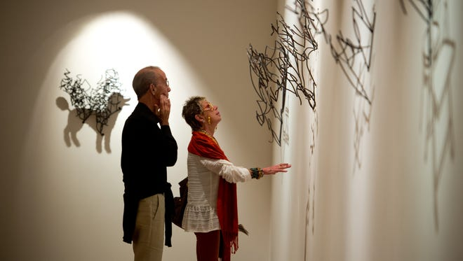 """Nila Moylan (right) and her husband, Larry Moylan, admire artist Larry Kagan's """"Object/Shadow"""" sculptures after watching the Ballet Vero Beach and Vero Beach Museum of Art collaboration for the Spring Interpretive Dance Performance on Friday, Feb. 17, 2017, at the museum in Vero Beach. Popular venues and events in Indian River County that have a significant economic impact on the local economy include theater performances at Riverside Theatre and exhibitions at the Vero Beach Museum of Art."""