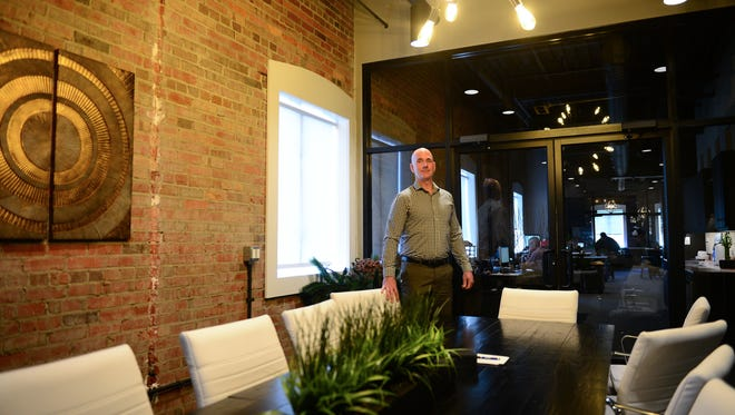 Andy Ball, SNV-Miller Commercial Real Estate, stands in one of the conference rooms available at Synergy 208, a co-work office space with desks and private offices available to rent on a monthly basis. Located in the heart of Downtown Salisbury. Friday, Feb. 2, 2018.