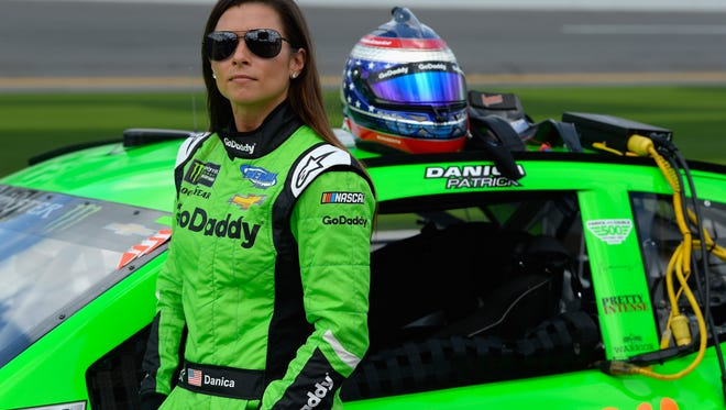 Danica Patrick, driver of the No. 7 GoDaddy Chevrolet, stands by her car during qualifying for the Monster Energy NASCAR Cup Series Daytona 500 at Daytona International Speedway on Feb. 11.