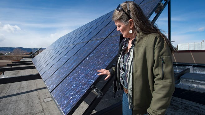 Facilities Engineer Carol Dollard takes a look at the solar panels on top of CSU's engineering building on Thursday, February 15, 2018. The panels were the first to be placed on campus nearly 10 years ago.