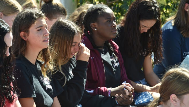 Marjory Stoneman Douglas High School students break down in tears during prayers for the shooting victims and community during a prayer vigil Thursday, Feb. 15, at Parkridge Church in Coral Springs.