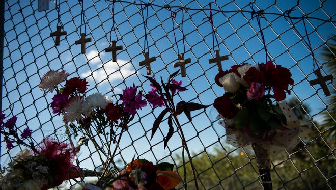 A small makeshift memorial is seen under the Sawgrass Expressway across from the entrance to Marjory Stoneman Douglas High School in Parkland on Feb. 15, following the mass casualty school shooting.